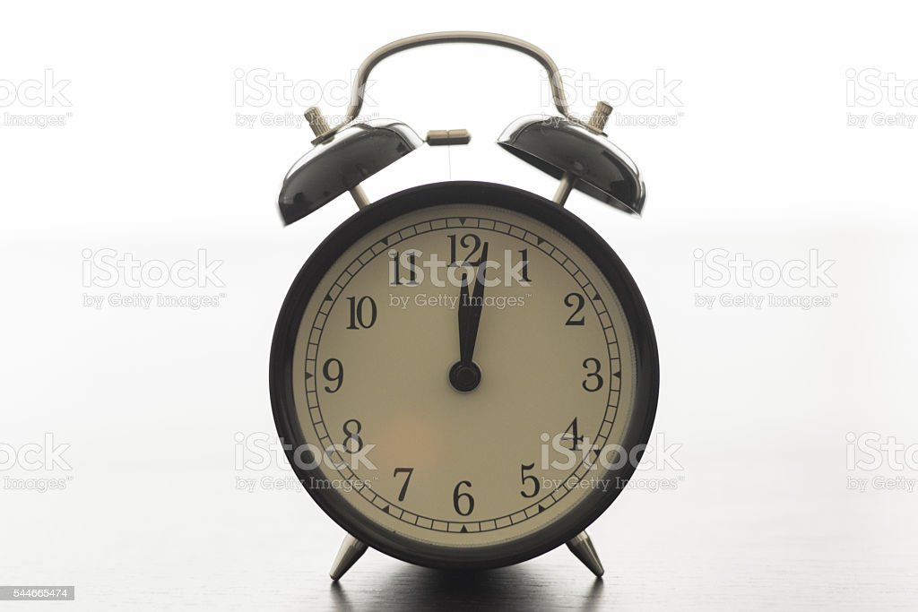 alarm clock at 12 o'clock stock photo