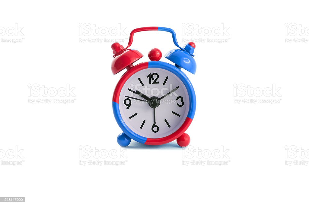 Alarm clock in blue and red stock photo