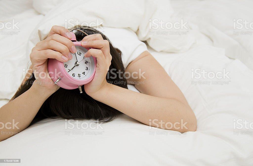 alarm clock in hand royalty-free stock photo
