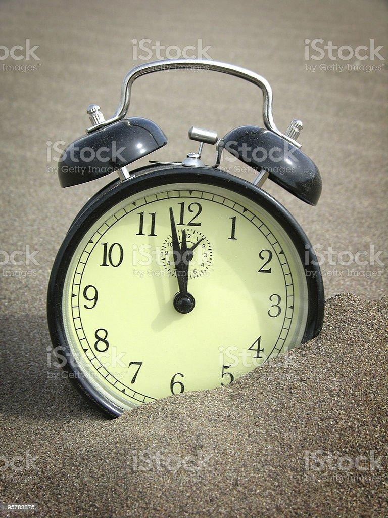 Alarm Clock in Sand royalty-free stock photo