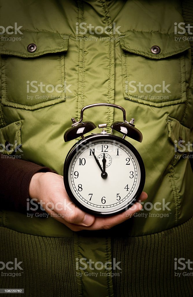 Alarm clock in the hand royalty-free stock photo