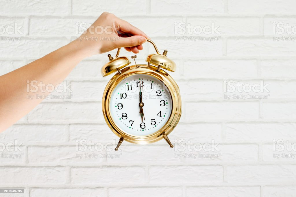 alarm clock on an empty background stock photo
