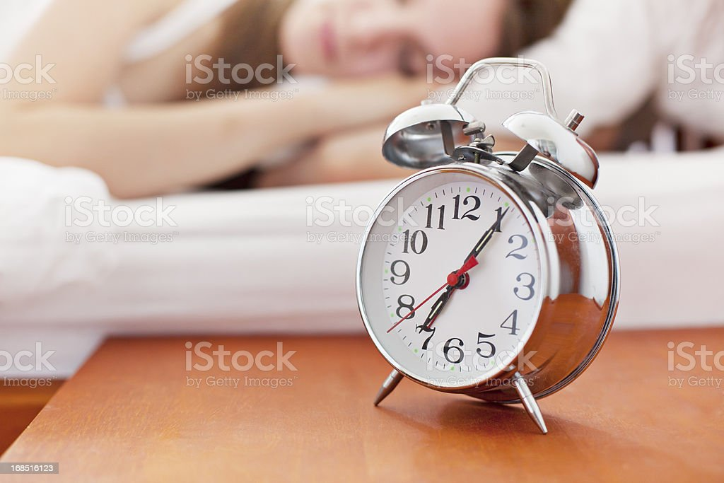 Alarm Clock on bedside table royalty-free stock photo