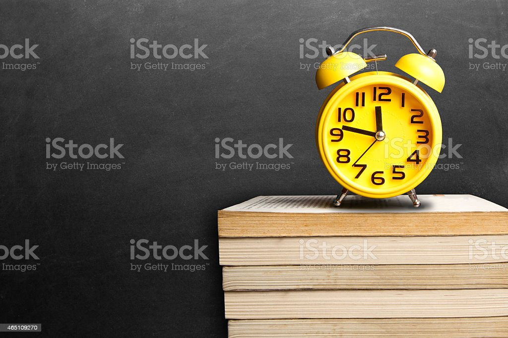 Alarm clock on book stock photo