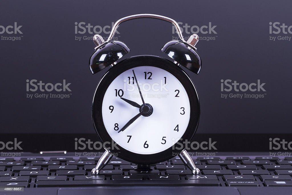Alarm Clock on Laptop stock photo