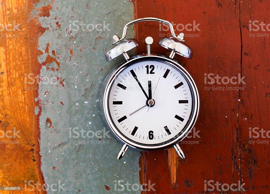 alarm clock on old table stock photo