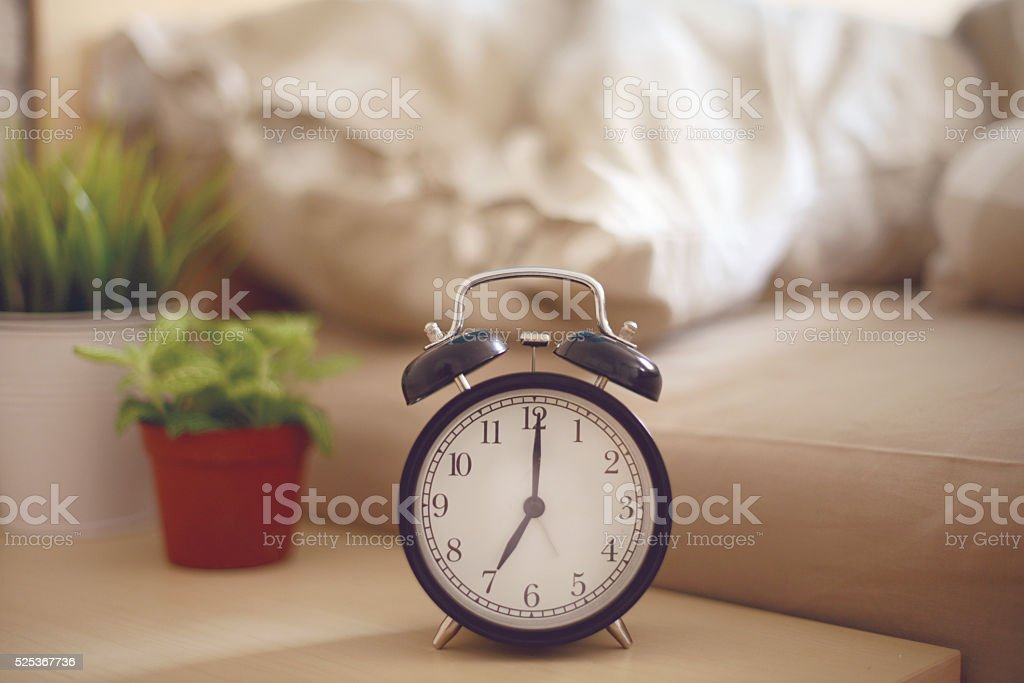 alarm clock on the Night Table in the bedroom stock photo