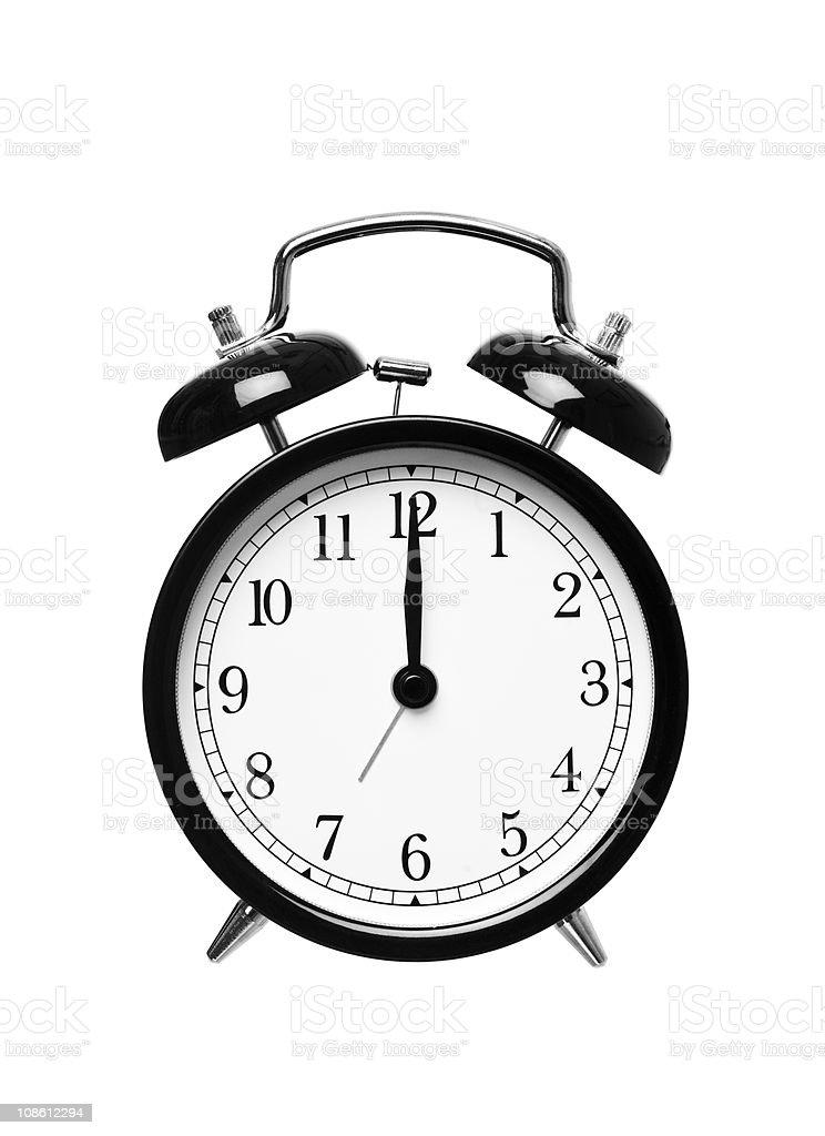 Alarm clock shows Twelwe o`clock stock photo
