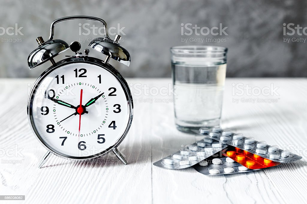 alarm clock time to take medicine stock photo