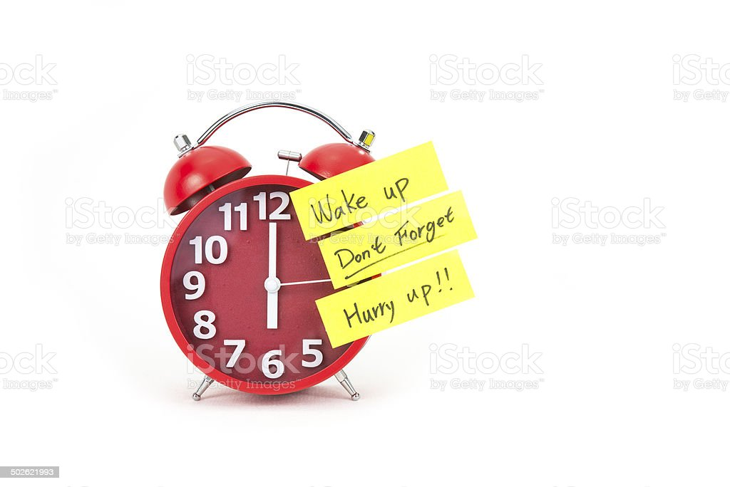 Alarm clock with a note stock photo