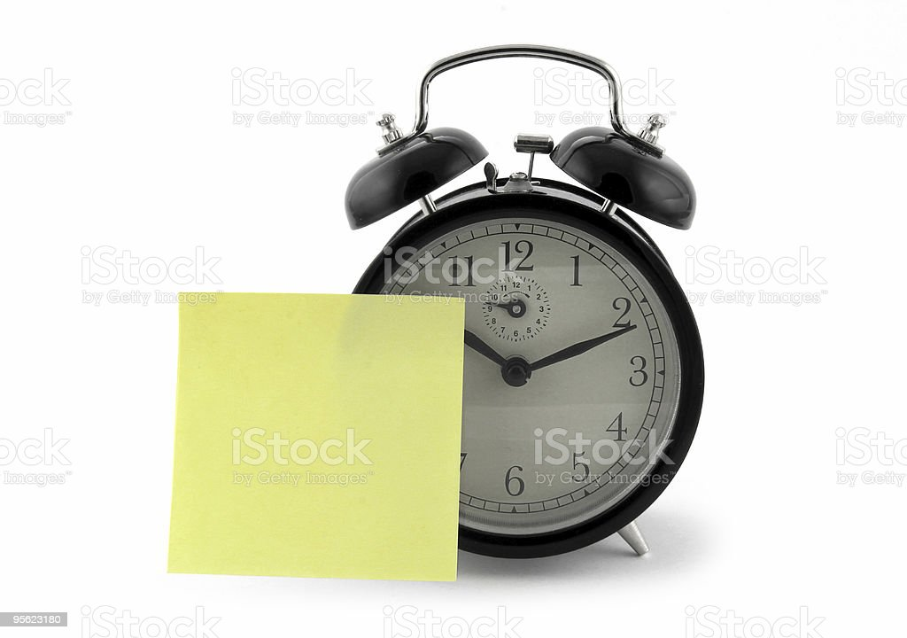 alarm clock with a note royalty-free stock photo