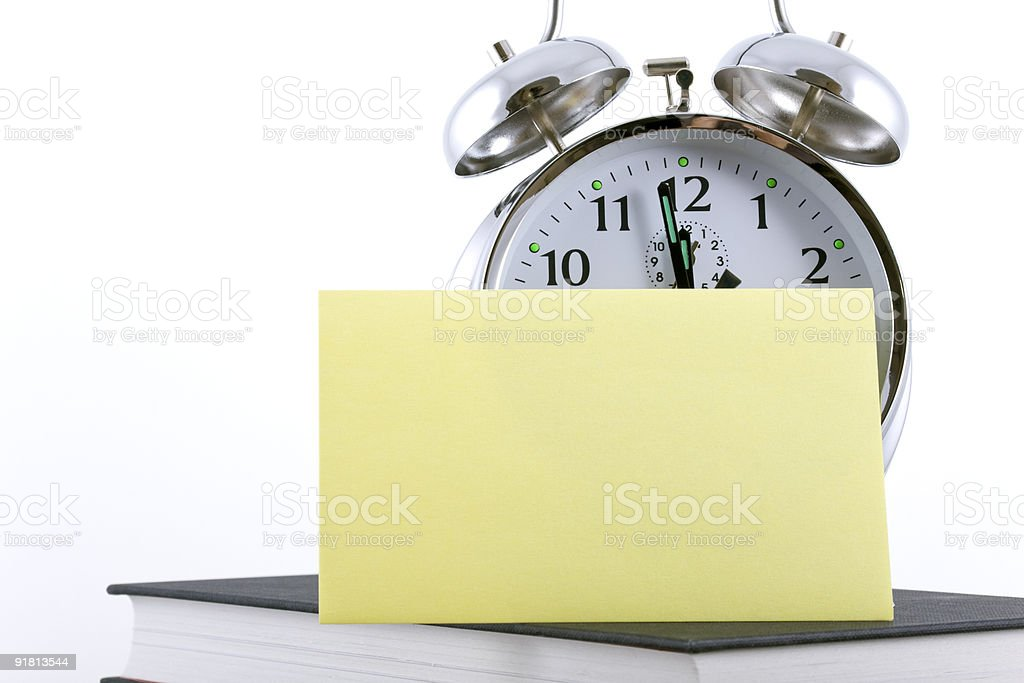 Alarm clock with blank adhesive note stock photo