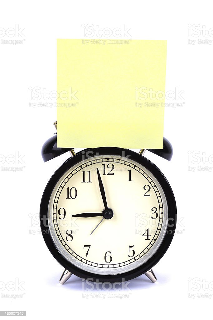 alarm clock with blank note isolated on white background stock photo