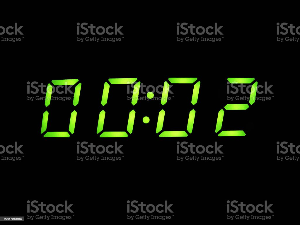 alarm clock with green digits stock photo