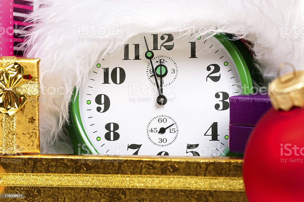 Alarm clock with santa hat royalty-free stock photo
