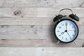 Alarm clock with wooden floor