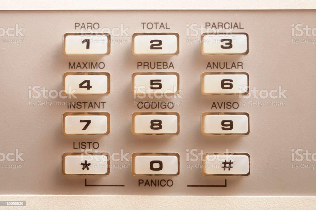 Alarm old-fashined keyboard in spanish language. stock photo