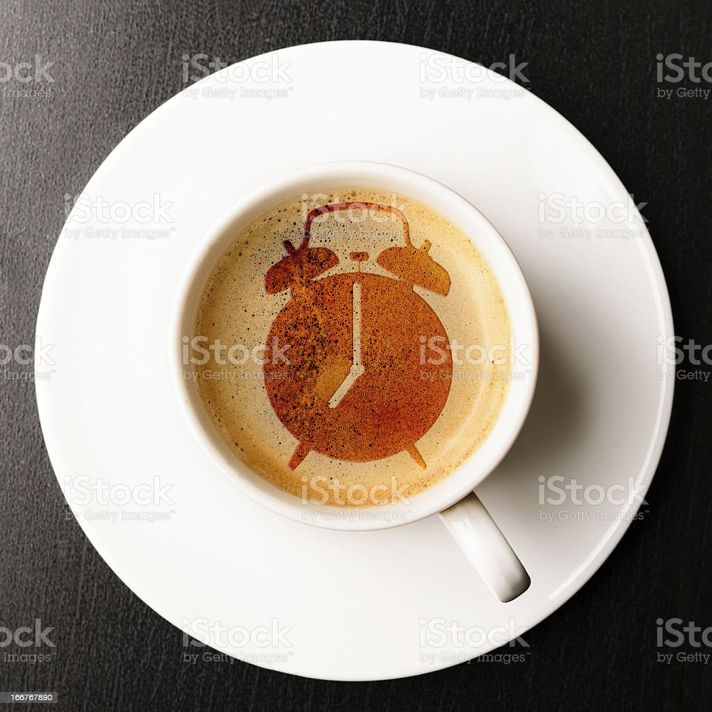alarm on cup of fresh espresso royalty-free stock photo