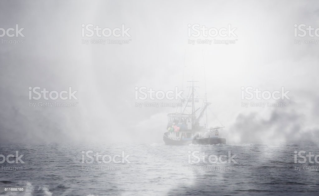 Alaska fishing trawler with fog overlay stock photo