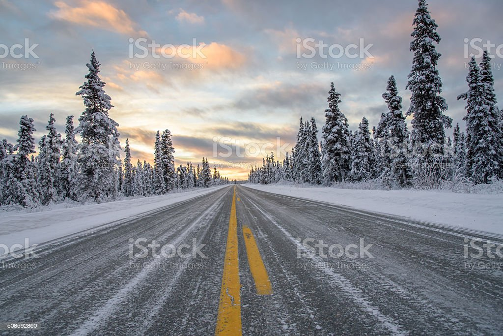 Alaska Remote Winter Highway at Sunset stock photo
