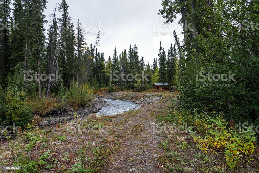 Alaska scenery with a cabin stock photo