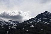 Alaska Skagway Dark Snowy Mountain Peaks