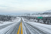 Alaska Winter Road and Sky With Distance Sign to Fairbanks