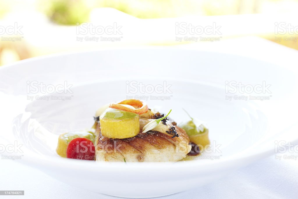 Alaskan halibut  with baby leeks, fennel and bacon sauce stock photo