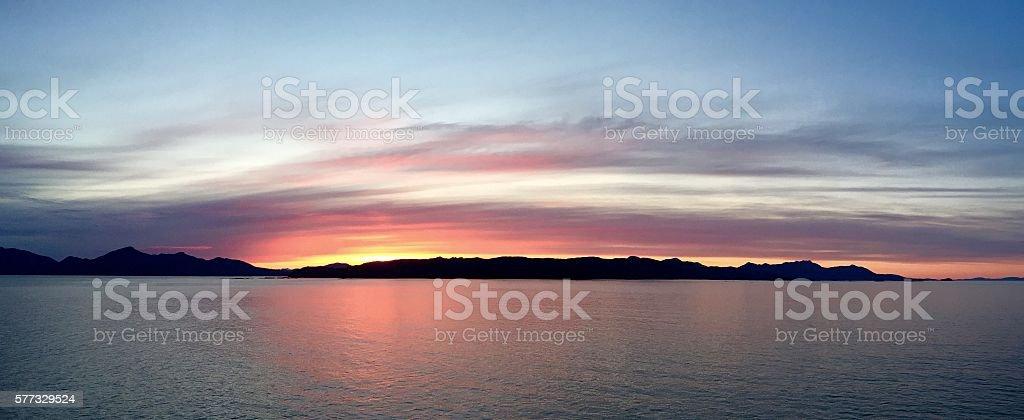 Alaskan Inside Passage Ocean/Island Sunset stock photo