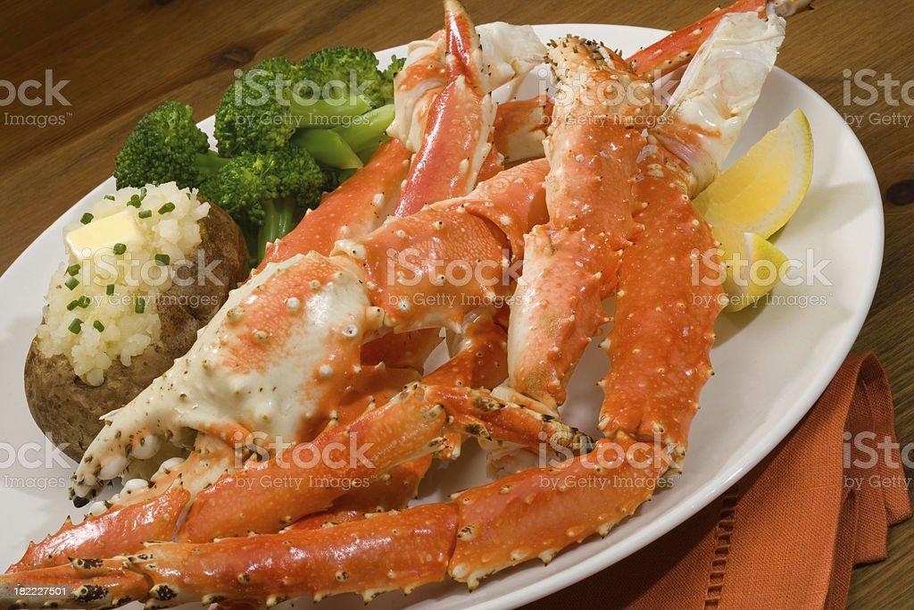 Alaskan King Crab leg  plated dinner stock photo