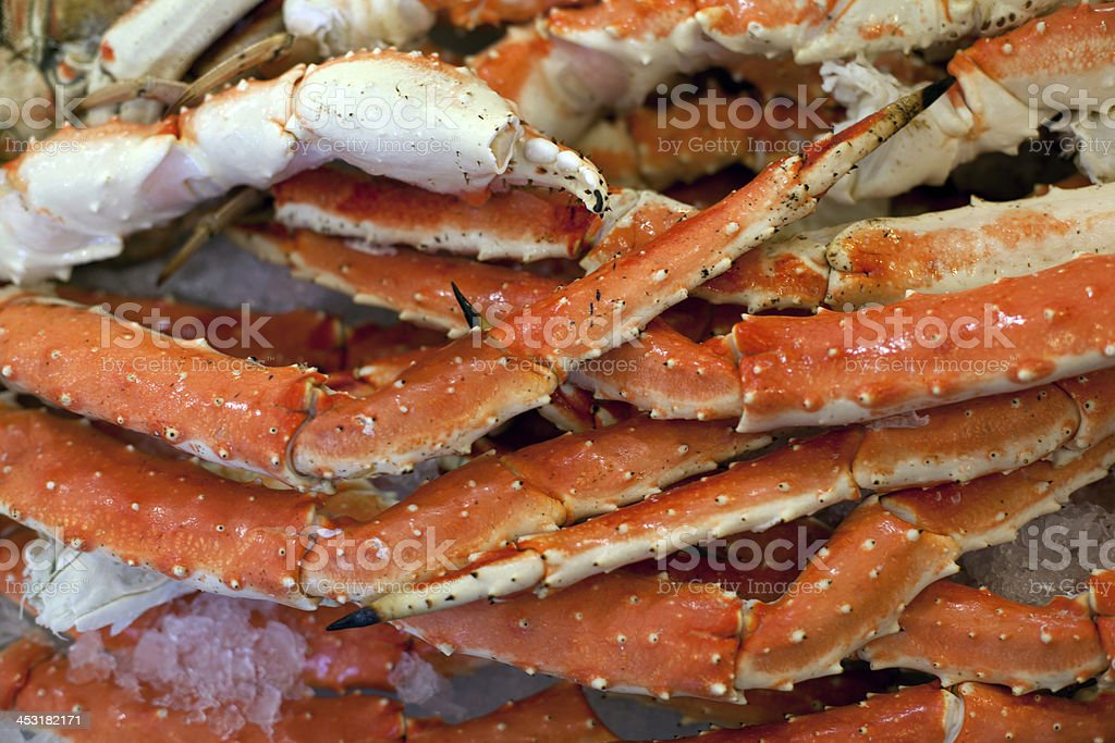 Alaskan King Crab legs on ice in market.  Close-up. stock photo