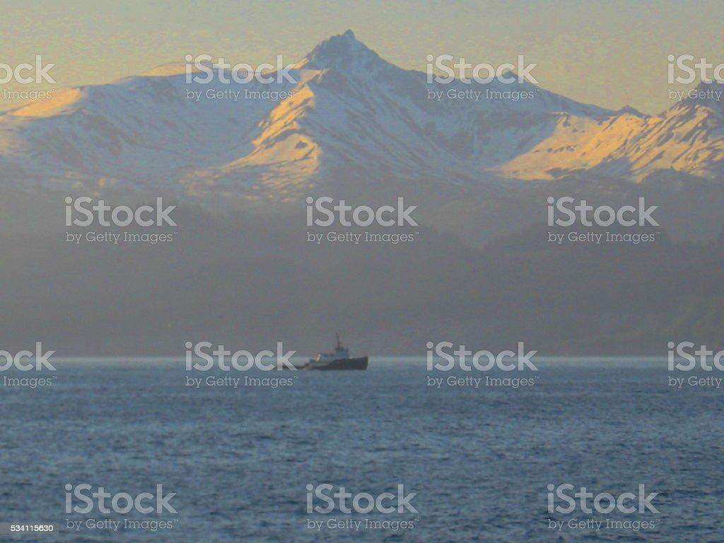 Alaskan Mountain Sunrise with Fishing Boat stock photo