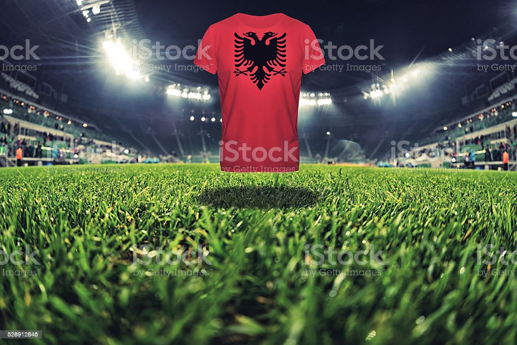 Albania national flag on t-shirt on football stadium stock photo