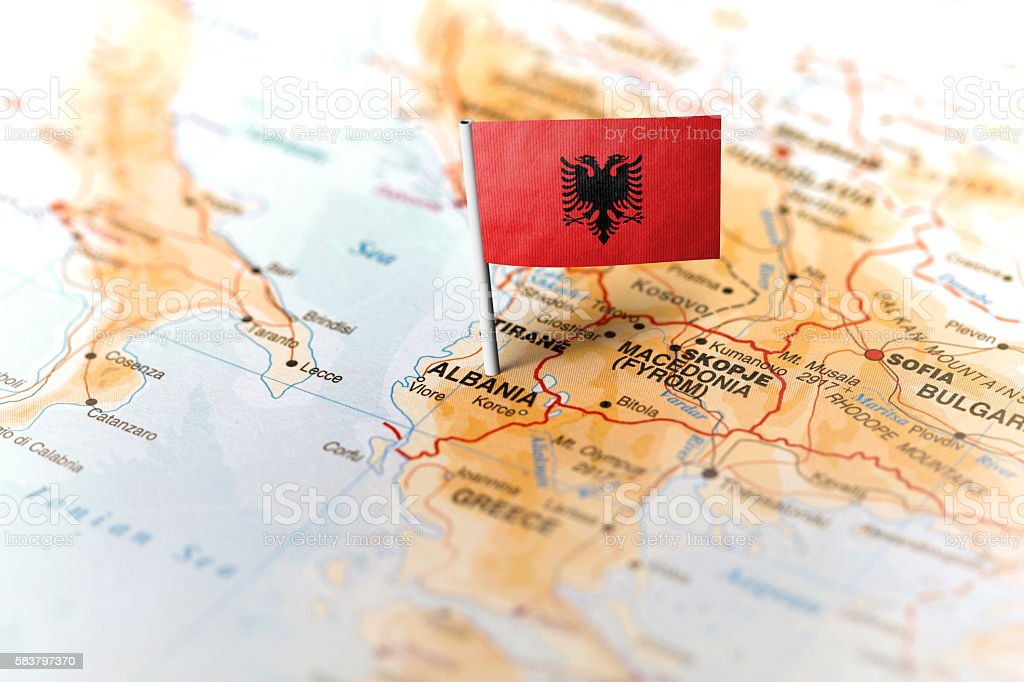 Albania pinned on the map with flag stock photo