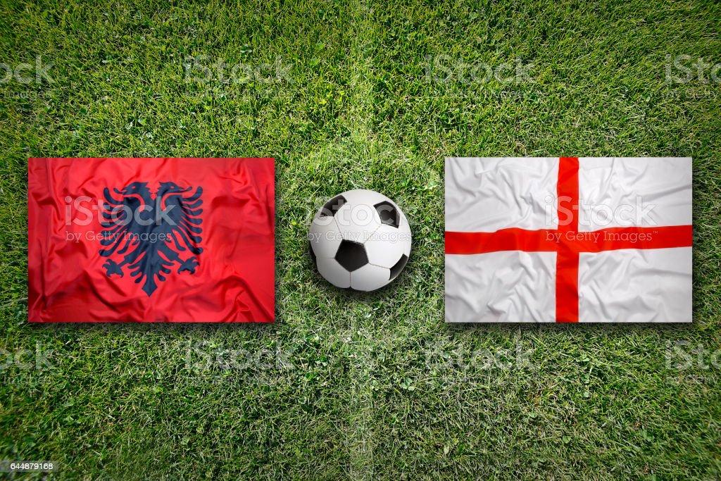 Albania vs. England flags on soccer field stock photo
