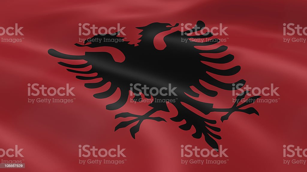 Albanian flag in the wind stock photo