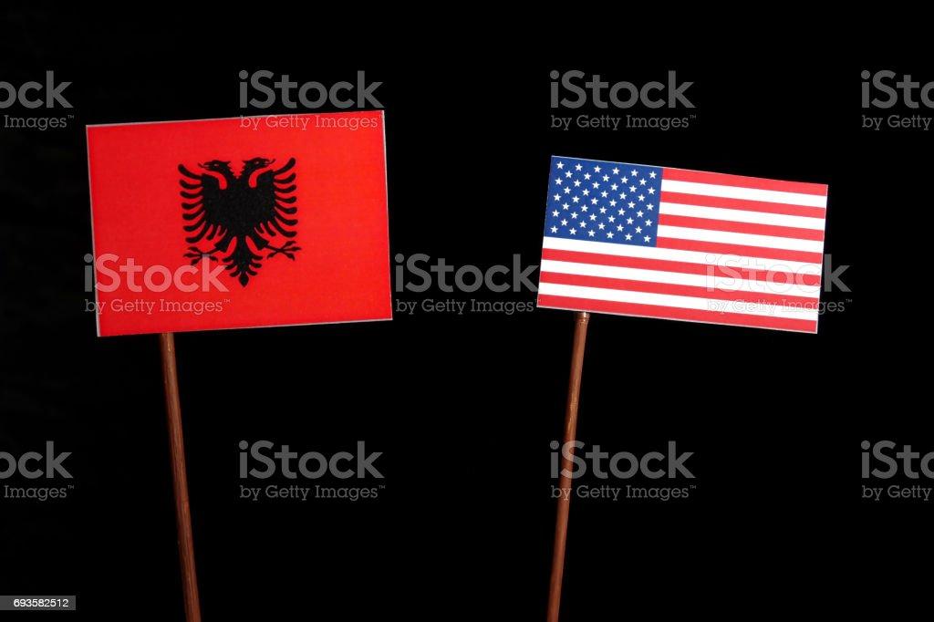 Albanian flag with USA flag isolated on black background stock photo