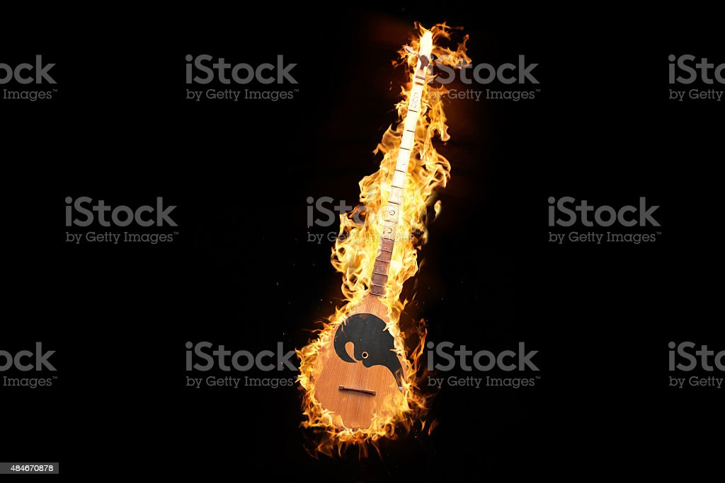 Albanian music instrument in flames stock photo