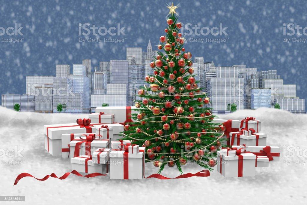 Albero di natale decorato e regali sotto la neve. Sfondo città.'n stock photo
