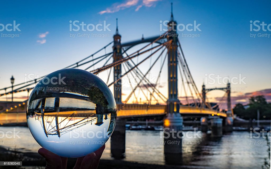 Albert Bridge in London, seen with a crystal ball stock photo