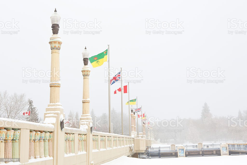 Albert Memorial Bridge with Saskatchewan Canada and United Kingdom flags stock photo