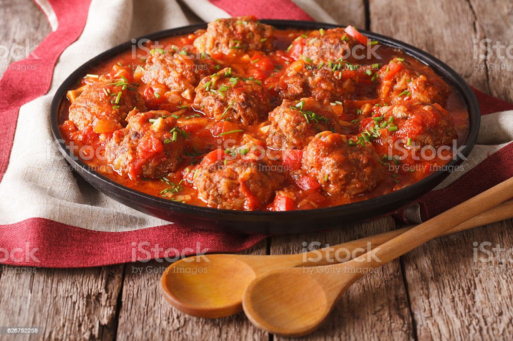 Albondigas meatballs with tomato sauce on a plate close-up stock photo