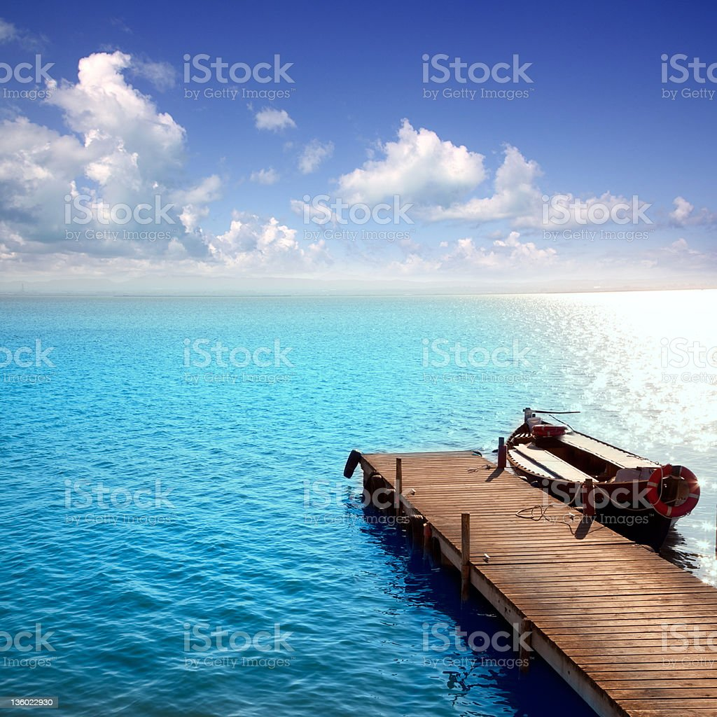 Albufera blue boats lake in El Saler Valencia stock photo