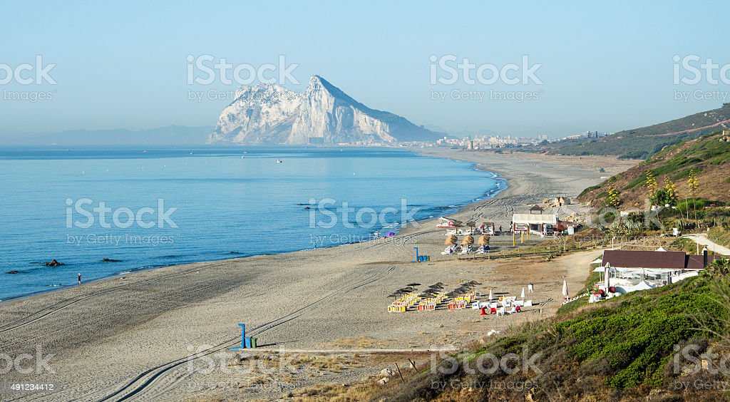 Alcaidesa beach with rock of Gibraltar in the background stock photo