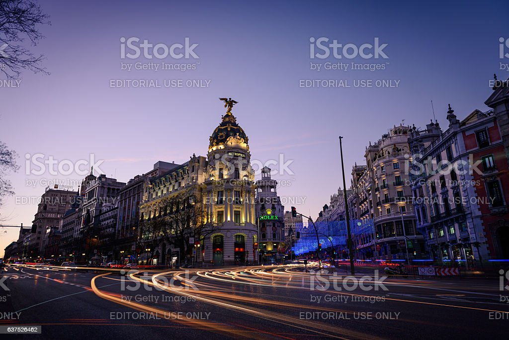 Alcala and Gran Via streets at dusk in Madrid stock photo