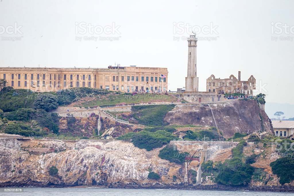 Alcatraz island under cloudy sky stock photo