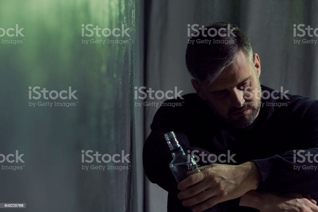 Alcohol addicted man stock photo