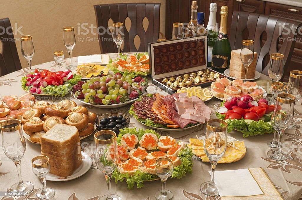 Alcohol and food on a table. royalty-free stock photo