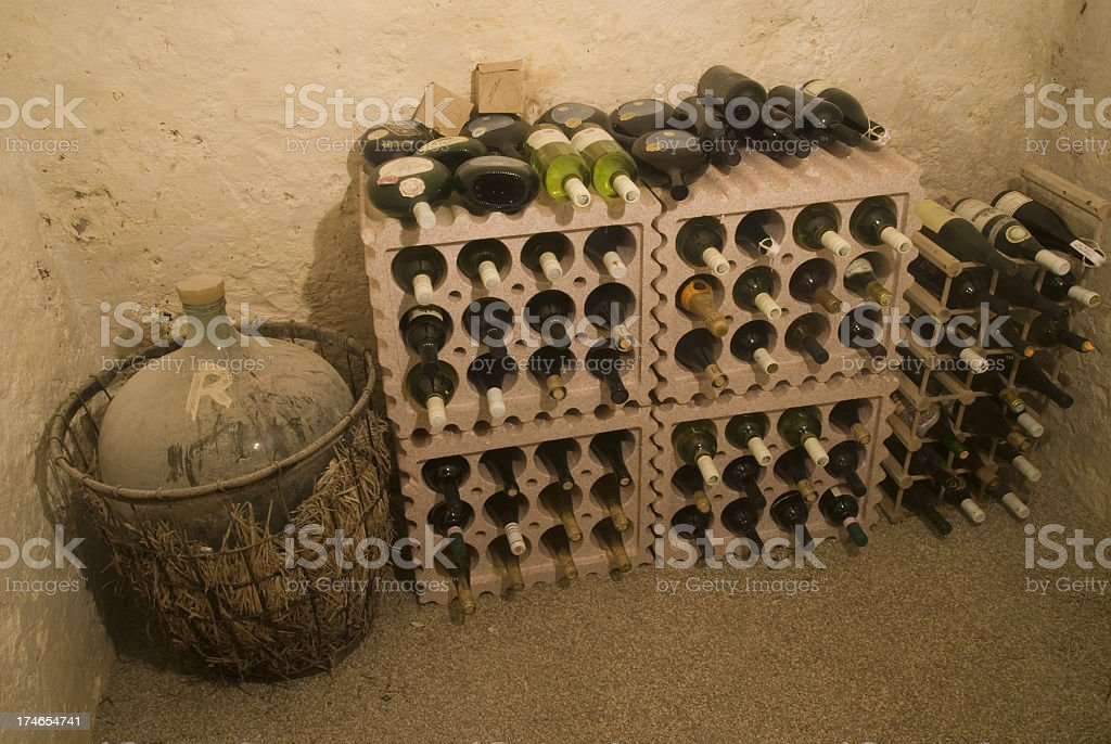 alcohol and wine in the cellar - Alter staubiger Weinkeller royalty-free stock photo