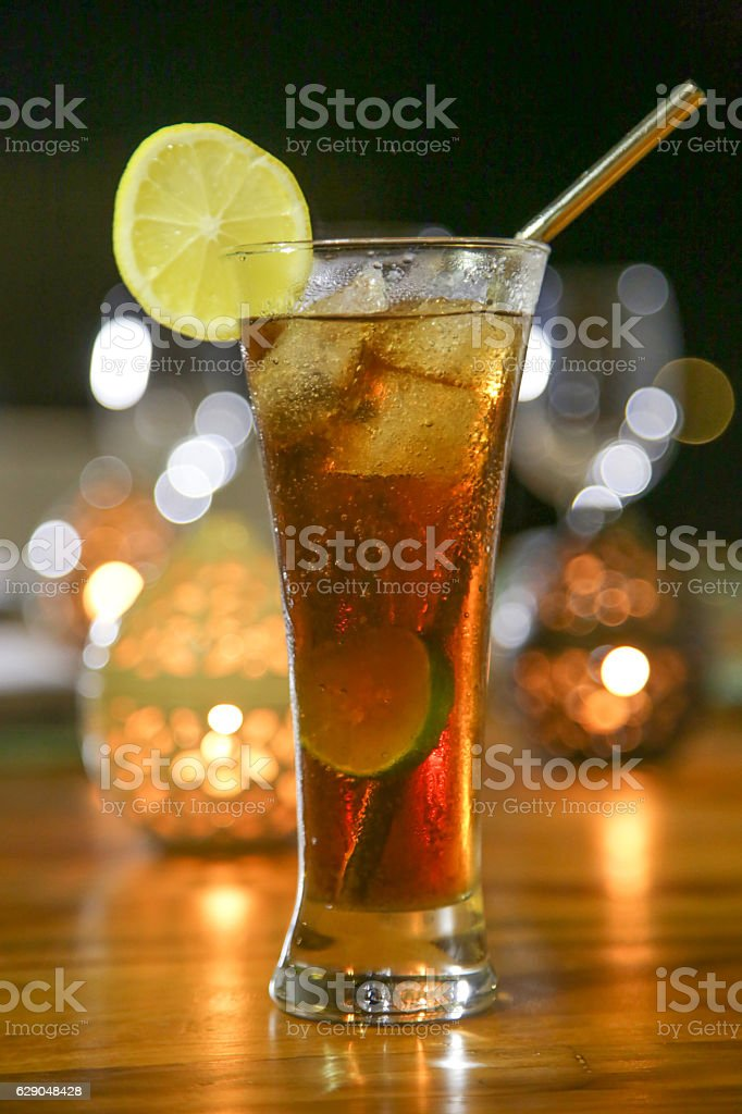 Alcohol cocktail drink on the table, dinner time, candle light stock photo